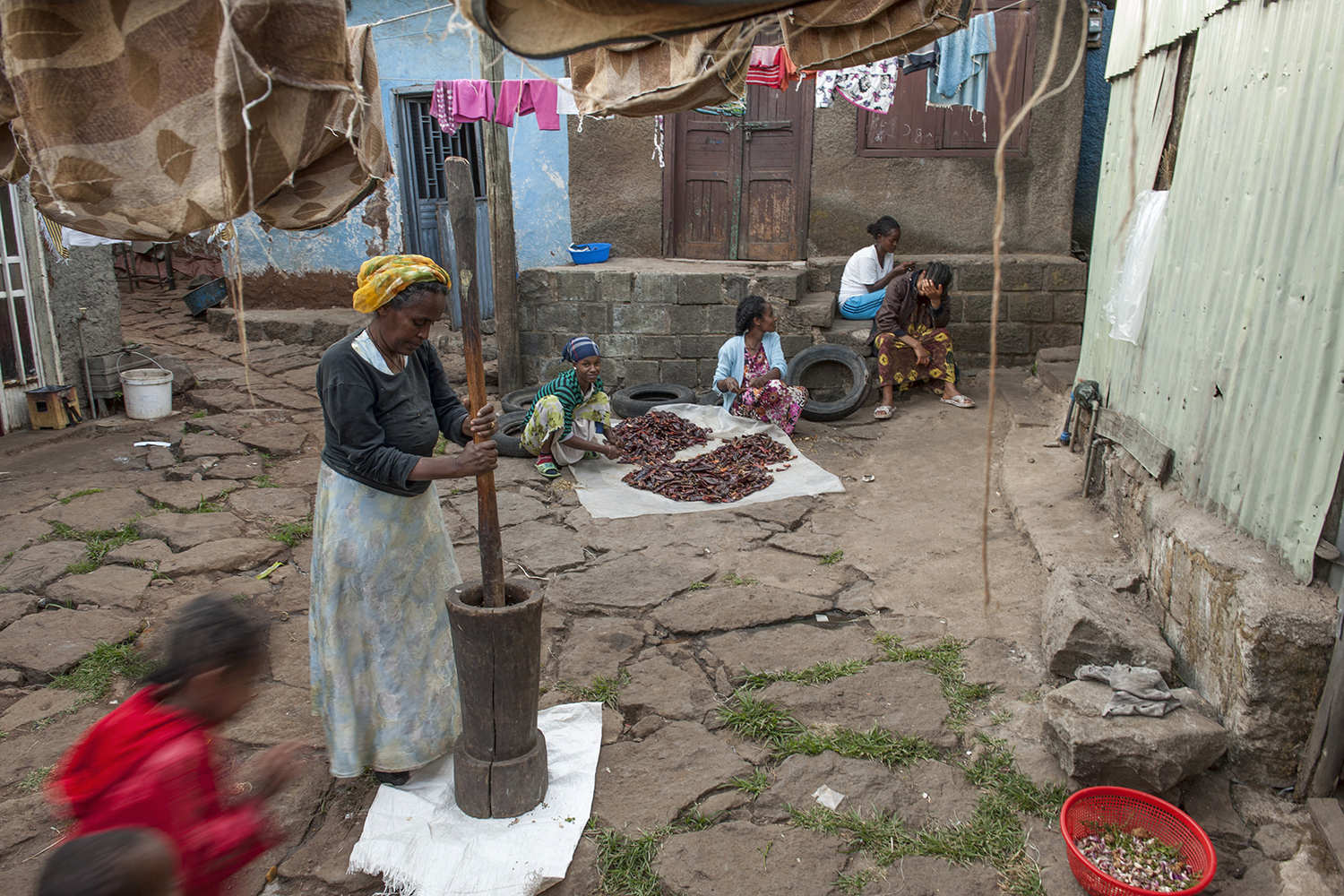 The dried chillies are mortared for the berbere